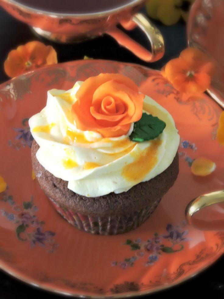 Tonka bean/chocolate cupcake topped with mandarin buttercream, mandarin sauce and handmade sugar rose  #tonkabean #chocolate #cupcake #mandarin # buttercream #handmade  #madewithlove