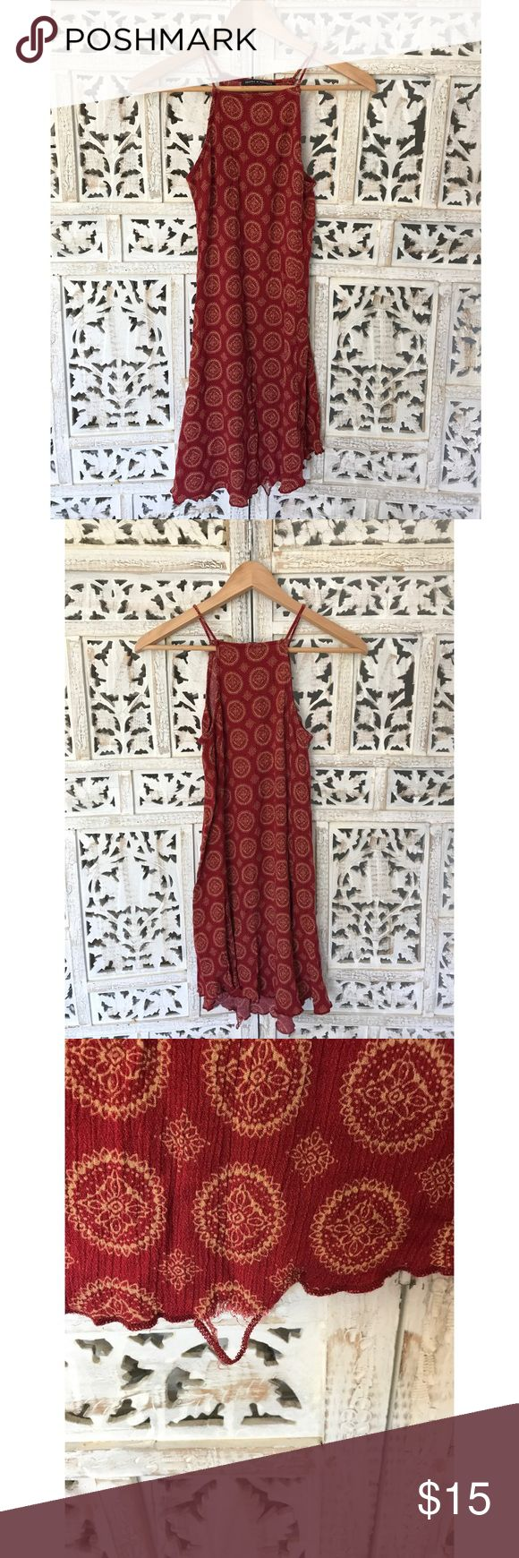 Brandy Melville henna print dress Gauzy trapeze neck sun dress from Brandy Melville. Bought in Venice Beach 2 summers ago and worn maybe 4x. My old washer's strongest feature was ripping my clothes so take notice of the hem coming undone in the attached pic. It's an easy fix to make the dress look like new. A tailor could even do it for a few bucks. Priced for the damage, no offers. Brandy Melville Dresses Mini