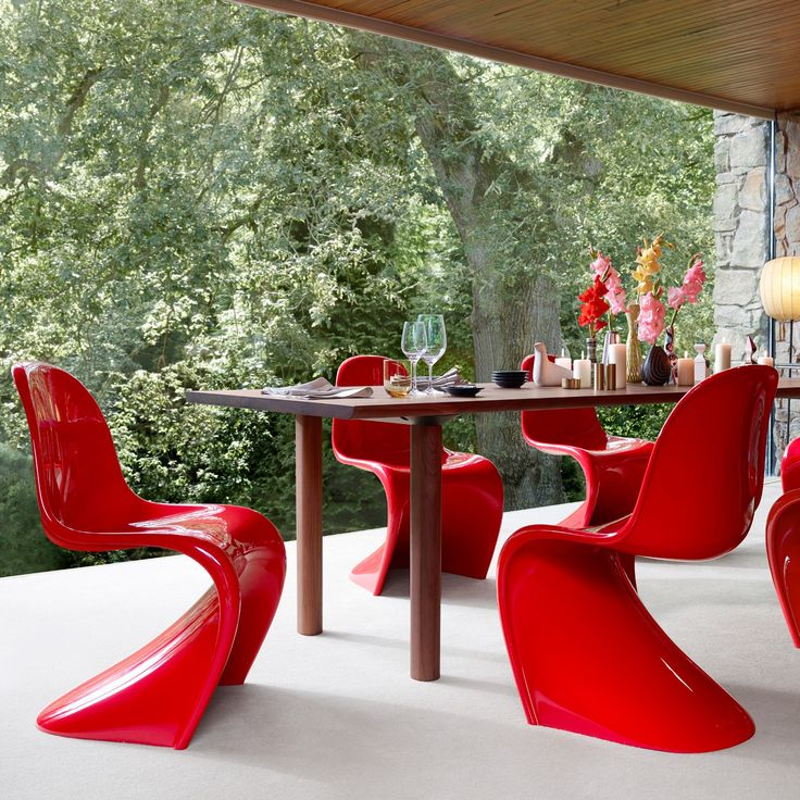 A classic piece of modern furniture, Danish designer Verner Panton spent many years thinking about how to produce a plastic chair in one piece. http://www.yliving.com/vitra-classic-panton-chair.html