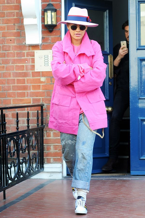 Rita Ora Brightens Up A Rainy Day With A Hot-Pink Parka  #refinery29  http://www.refinery29.com/2015/03/84092/rita-ora-pink-coat-outfit#slide-1  Rita Ora was photographed in London wearing a fuchsia jacket, paint-splattered jeans, and Adidas Superstars that would make your eighth grade self swoon.