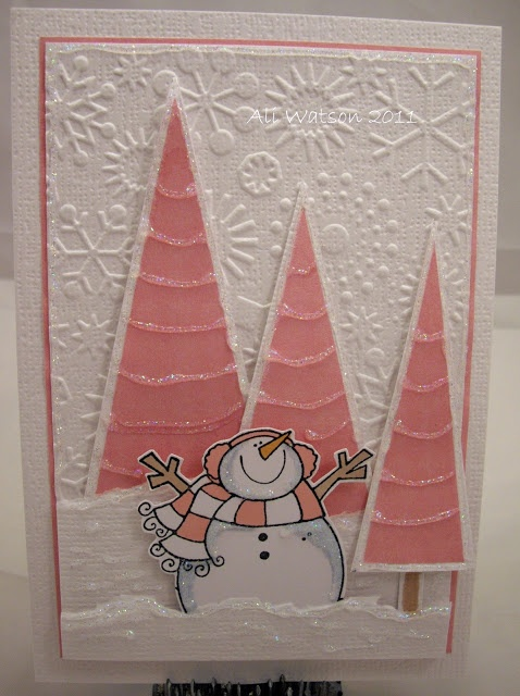 winter card ... pretty in pink and white ... luve the pink triangle trees and the pink scarf on the santa ... embossing folder snowflake background ... sparkly lines of irridescent Stickes ... lovely!!