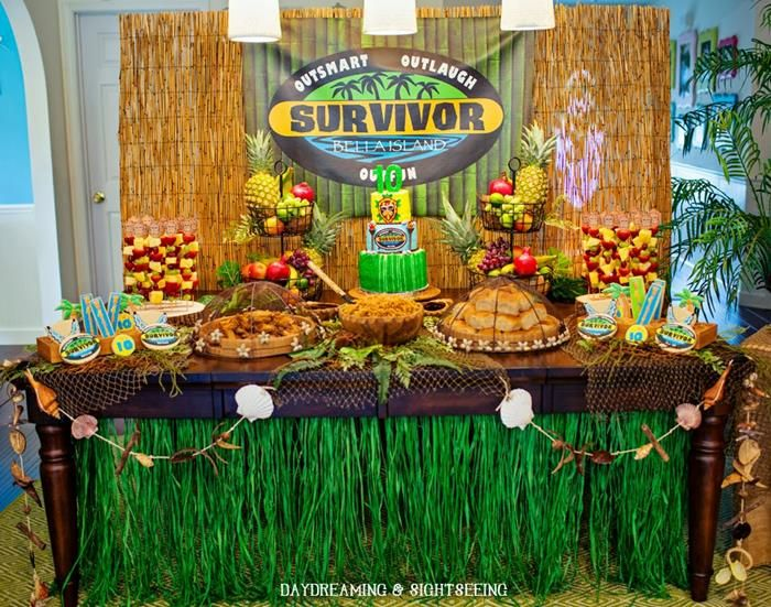 Blue and Gold Survivor--I like the grass skirts on the tables, and the burlap + netting as table cloths