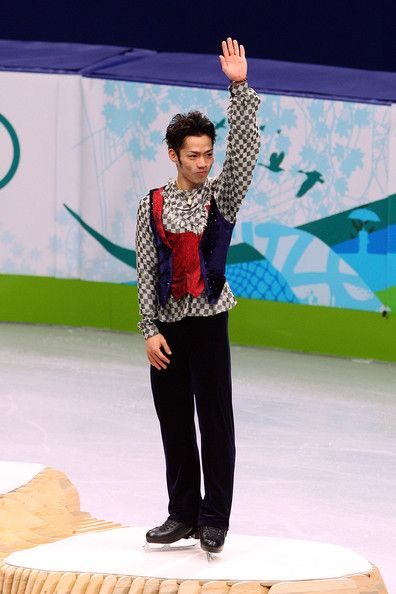 Daisuke Takahashi Photos Photos - Bronze medalist Daisuke Takahashi of Japan waves to the crowd in the men's figure skating free skating on day 7 of the Vancouver 2010 Winter Olympics at the Pacific Coliseum on February 18, 2010 in Vancouver, Canada. - Figure Skating - Day 7