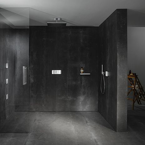 A sensuous shower experience featuring an overhead shower, side and hand shower, controlled by the Axor One control unit.