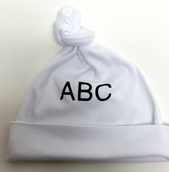 ABC Baby hat. Heat pressed in black.  Top knotted. Hand made from 100% Canadian Milled cotton interlock. 0-6 months. Wash and dry.