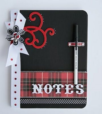 mini composition notebook: note the pen holder on the front cover