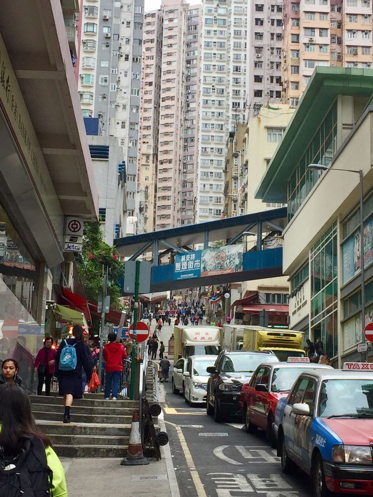 Bill ✔️ Sai Ying Pun (Sheung Wan) Hong Kong Island, Hong Kong , on Centre Street and First Street. The large grey building to the right is the produce (Wet) Market for this part of town. Meat, Fish, etc.    Bill Gibson-Patmore.  (iPhone image, curation & caption: @BillGP). Bill ✔️.