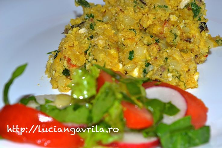 Păpăradă (scrambled eggs) with meat leftovers and cheeses