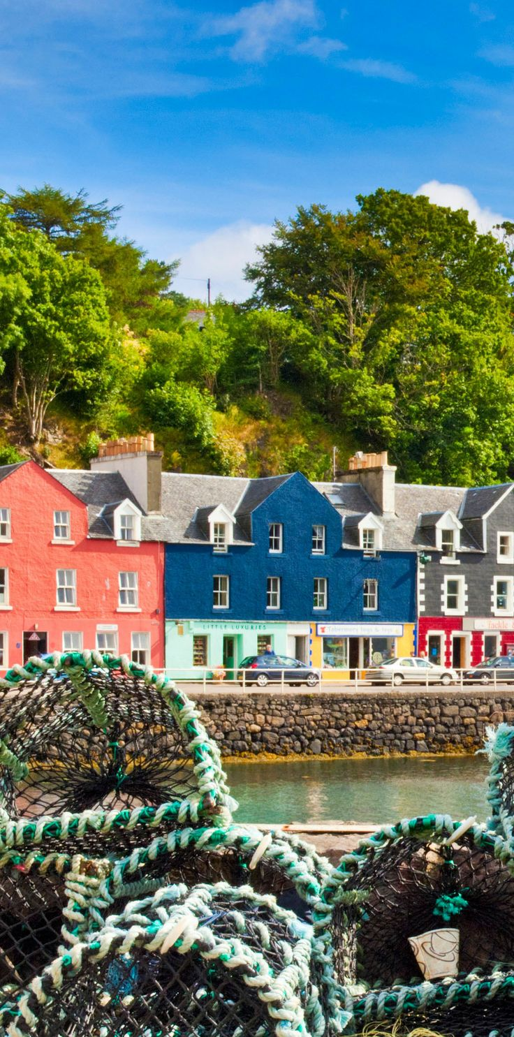Colourful houses of Tobermory harbour and lobster pots on the Isle of Mull in the Scottish Inner Hebrides.