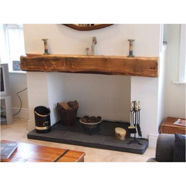 Oak beam, slate hearth stick in a wood burning stove