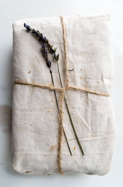 Give The Gift of Fresh-Baked Bread | Wrap a loaf of banana bread in a flour sack dish towel, tied with twine and a sprig of lavender.