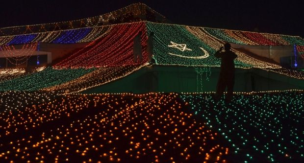 Men are silhouetted as they work to illuminate the Balochistan Assembly building in celebration of Pakistan's Independence Day in Quetta. Pakistan commemorates its Independence Day on August 14. Photograph: Naser Ahmed/Reuters