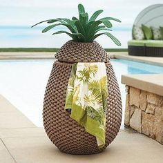 This tropical towel hamper: | 13 Crazy Pool Accessories That Totally Redefine Cool