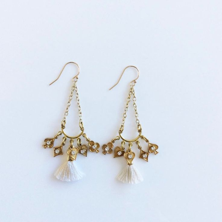 The Cream Suits Me Earrings are made from gold filled ear wires, gold plated chain and charms and hand made French cotton tassels.