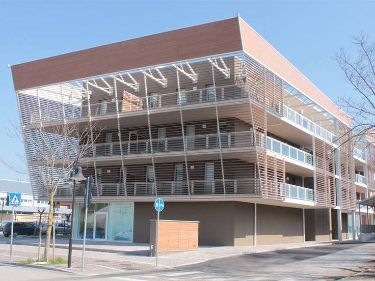 Edificio per residenze e per negozi. Il progetto nasce