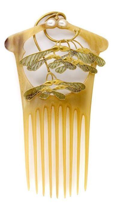 An Art Nouveau comb, by René Lalique, France, circa 1900. Composed of gold, patinated blond horn, enamel and pearls. H. 16 cm. #Lalique #ArtNouveau #comb