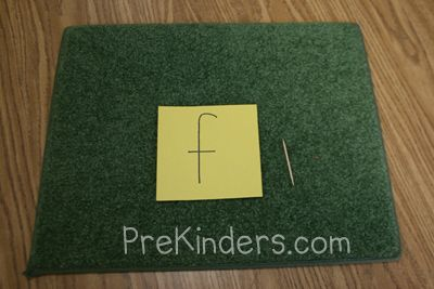 Write a letter on a piece of construction paper (I use a half sheet). Children sit on the carpet and use a toothpick to punch holes along the lines of the letters. Turn out the lights, and hold a flashlight to the back of the letter to see the light shining through (or hold the letters up to sunlight from a window).
