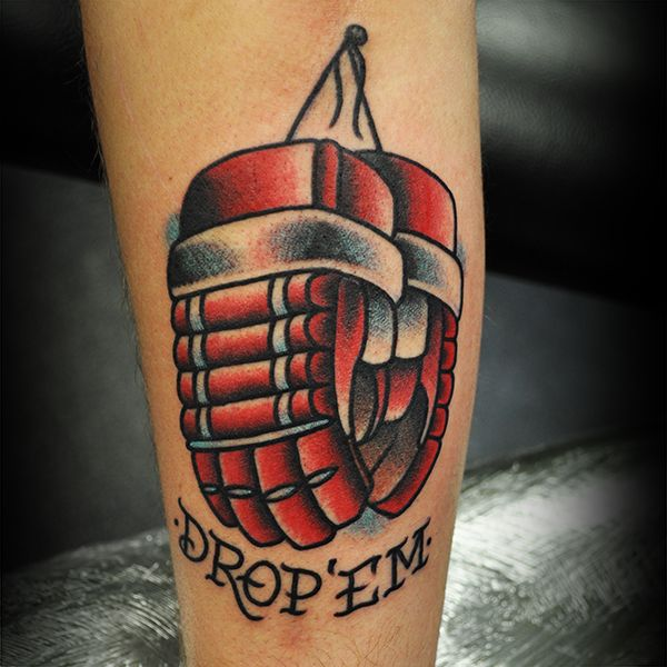 "A tattoo of Red Hockey Gloves and the words ""Drop 'Em"" by Steve Fawley"