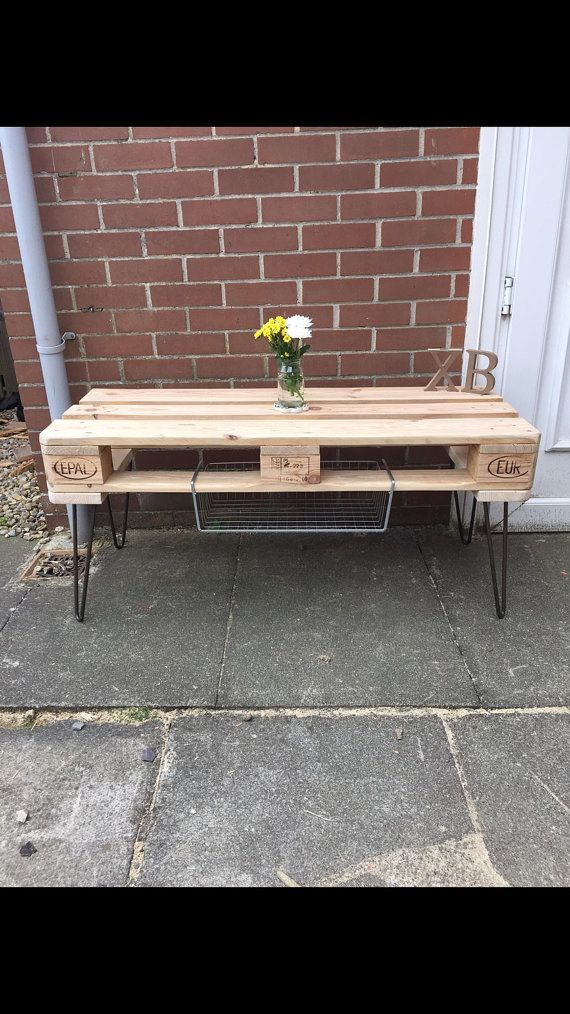 Here we have a standard Xb euro pallet table. The example pallet is sanded to give a rustic finish. We offer a range of finishes so if you are looking for anything in particular please feel free to ask. The hairpin legs stand 14 inches tall, total hight of the table is 19 inches. The pallet table is 47 inches in length and is 18.5 inches wide. The hairpins are available in a range of sizes based on your requirement and any colour/ finish you like :) the table has two wire storage compart...