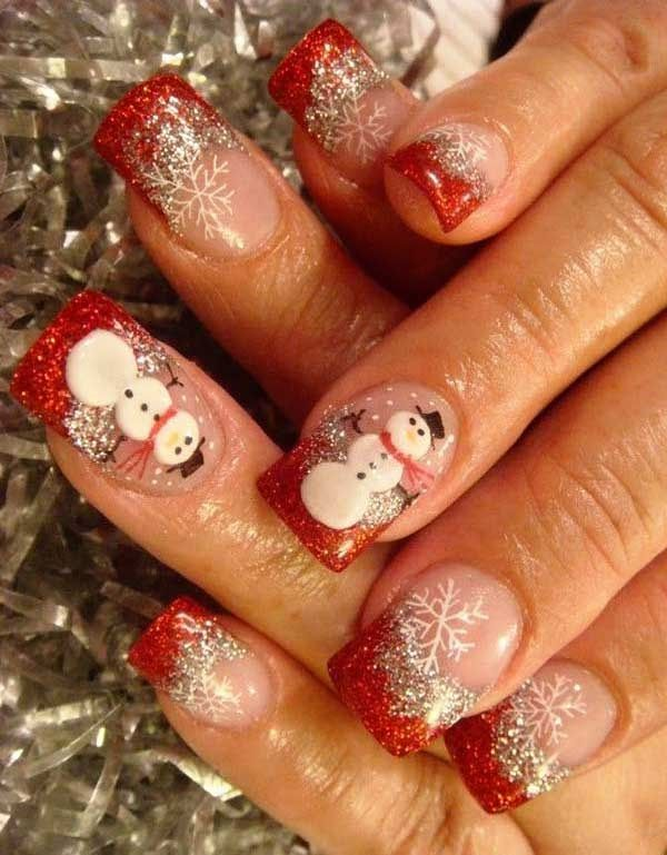 Fill your nails with this glittery red and white Christmas nail art design. Use glitter polish for the French tips and add snowflakes falling all over the nails. A cute snowman is also a great way to cap off this design.