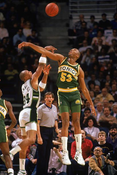 Alton Lister of the Seattle Supersonics attempts to block a shot by Terry Cummings of the Milwaukee Bucks during the 19881989 NBA season