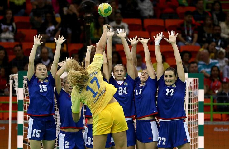 Players of Russia try to block the shot of Linnea Torstensson of Sweden during a handball match. Lars Baron/Getty Images