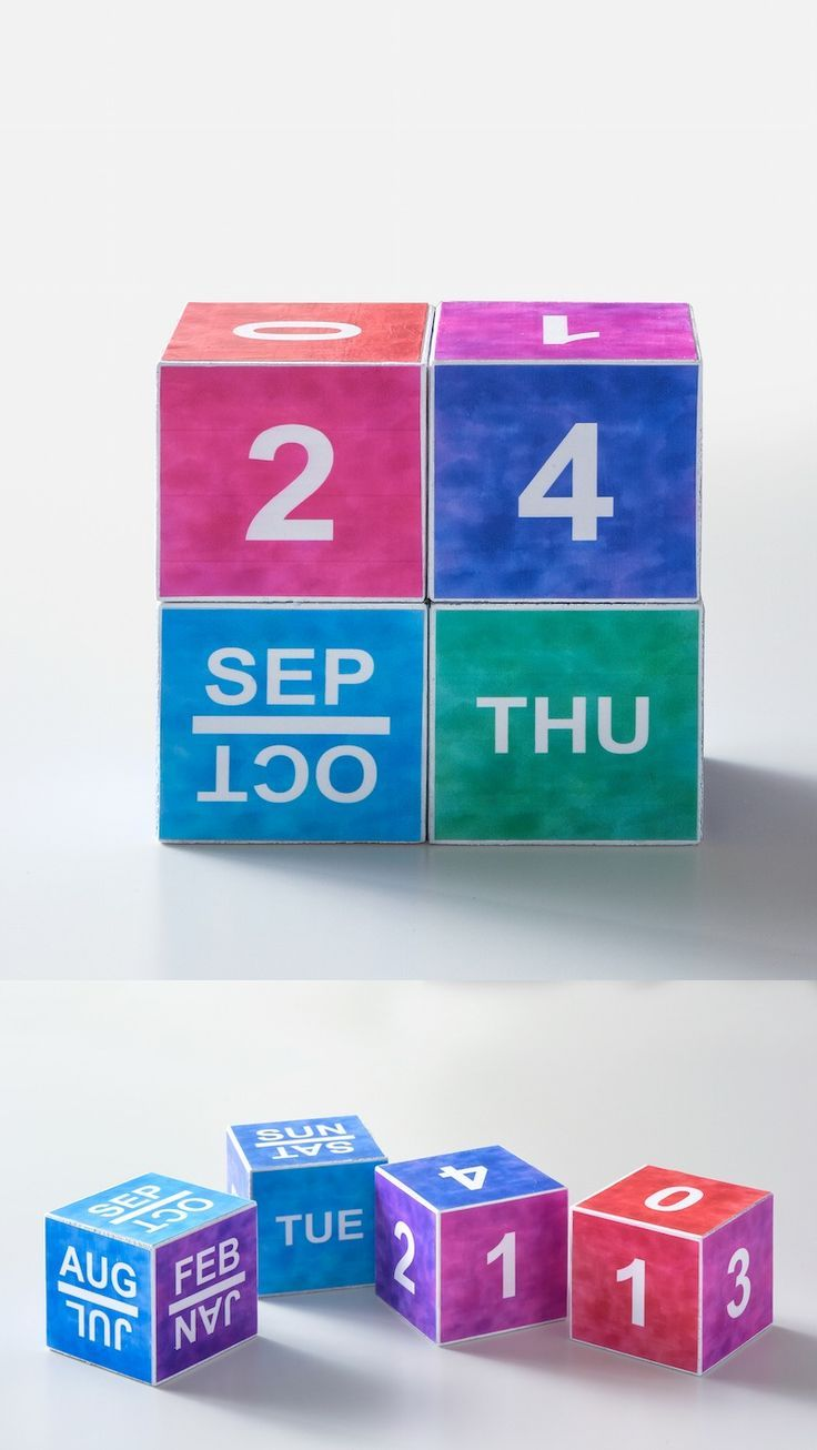 Make a watercolor perpetual calendar using wood blocks, Mod Podge, and the free printable you can get by clicking through!