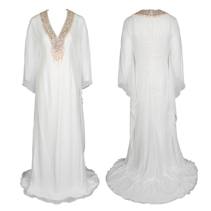 A white floor-length Kaftan dress with a beaded V-neckline by Jovani Couture #jovani #hautecouture #white #ramadan #brocade #kaftan #embellishment #luxury #gbmoda #greenbird #abudhabi #fashion #trend #elegance #beading #marinamall #dubaifashion #dress