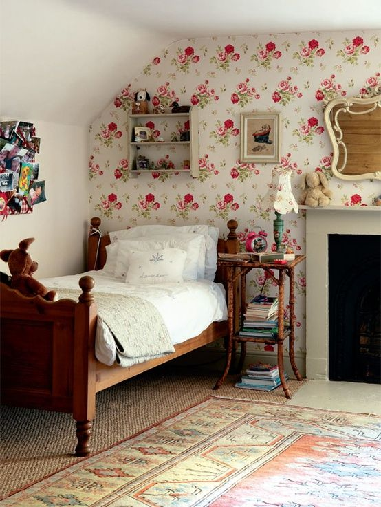 The floral wallpaper, the one wallpaper wall, the old bed... This whole room is perfect.