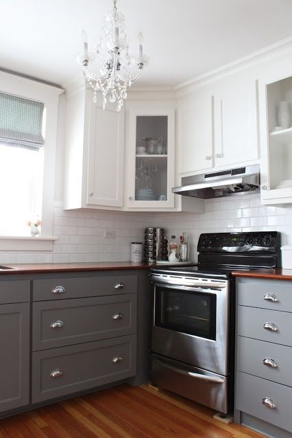 dark bottom cabinets white top cabinets half the painting love