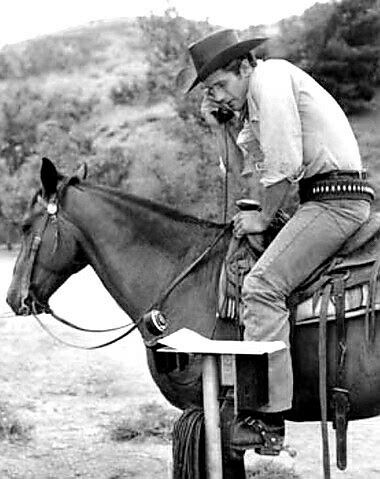 TV Actor Robert Fuller, on a horse and on the Phone.