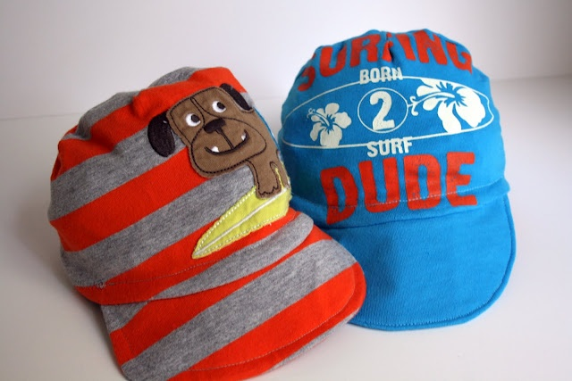 I could make Allie girlie ones!!!     -----diy baby boy hats... from ONESIES. I so need to recycle some of the twins' clothes and do this!