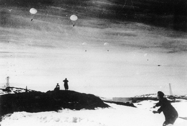 Waves of German paratroopers land on snow-covered rock ledges in the Norwegian port and city of Narvik, during the German invasion of the Scandinavian country