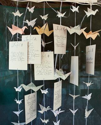 Hanging paper cranes and table seating display