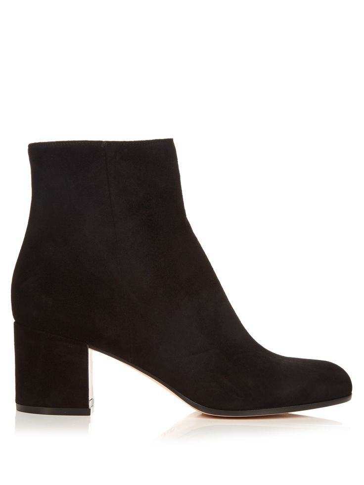 Gianvito Rossi's black suede Margaux ankle boots will fast become a year-round staple. They have a sleek, round-toe shape that fastens with a silver-tone metal zip, and feature a mid-high block heel that will bring a chic feel to a classic day dress.