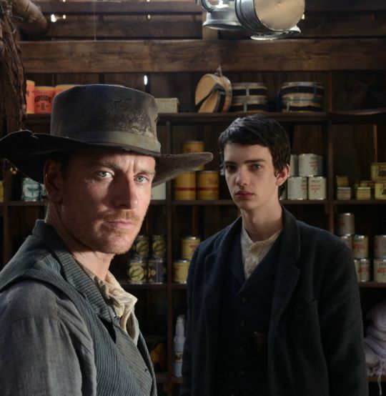 Michael Fassbender with Kodi Smit-McPhee in Slow West