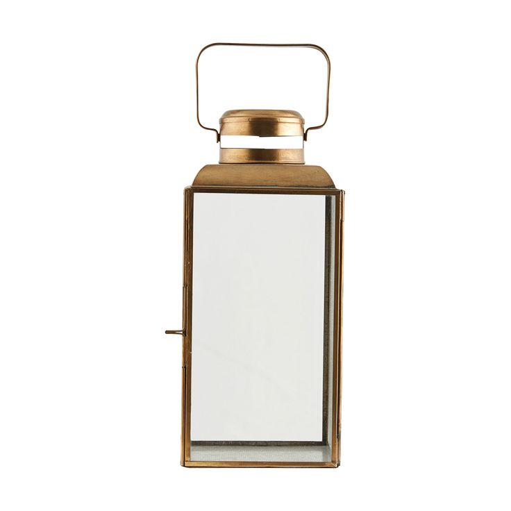 Lantern Brass: Brass plated lantern.  Can house a small tea light to large pillar candles.  Indoor our outdoor use.