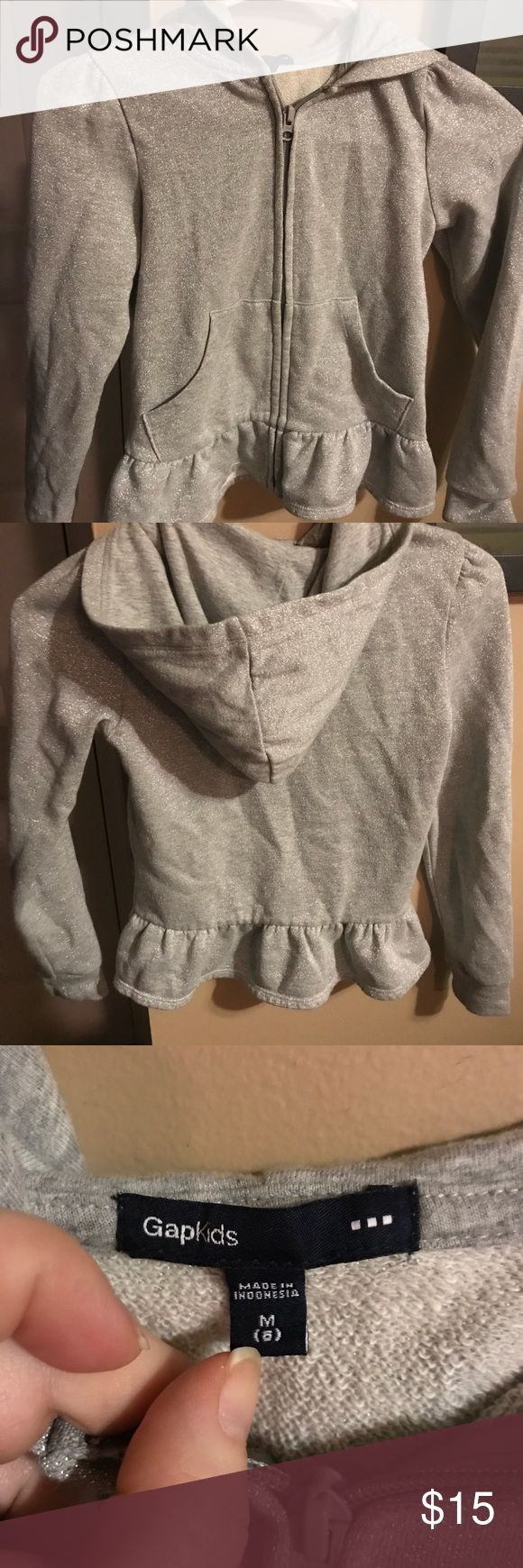 Hoodie Girl's sparkly silver hoodie with ruffle detail at hem in like new condition! GAP Shirts & Tops Sweatshirts & Hoodies