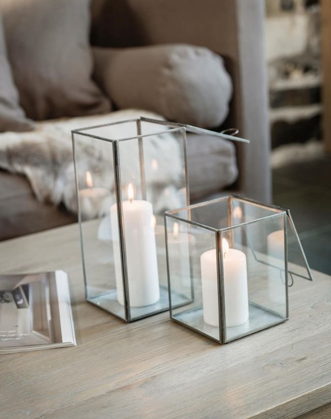 Love the crisp, white look of a pillar candle inside the lanterne