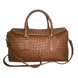 Ladies Handbags  [http://www.divyainternational.com/corporate-video.html]  Welcome to Divya International. Manufacturer & Exporter of Leather Products, Accessories & Promotional Items. Established in the year 2006, we are guided by Mr. Aman Dewan. Spacious & Highly automated warehouse make us the first choice of our clients. Innovative designs, Cost effectiveness & Premium quality leather make us the preferred supplier in the industry