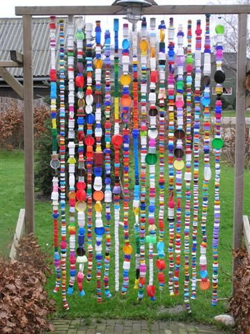 ... a bit of garden whimsy ... made of bottle caps between the trees in the back....maybe in the school courtyard?