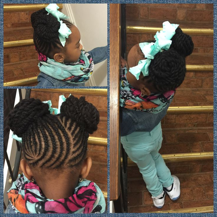 Very cute double bun hairstyle done on natural hair! Love the cornrow pattern.