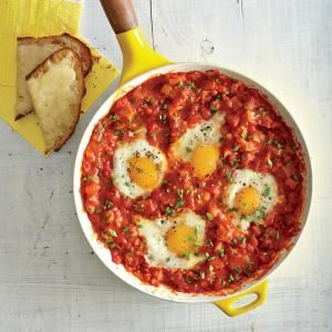 Eggs Poached in Tomato Sauce with Garlic Cheese Toasts | MyRecipes.com