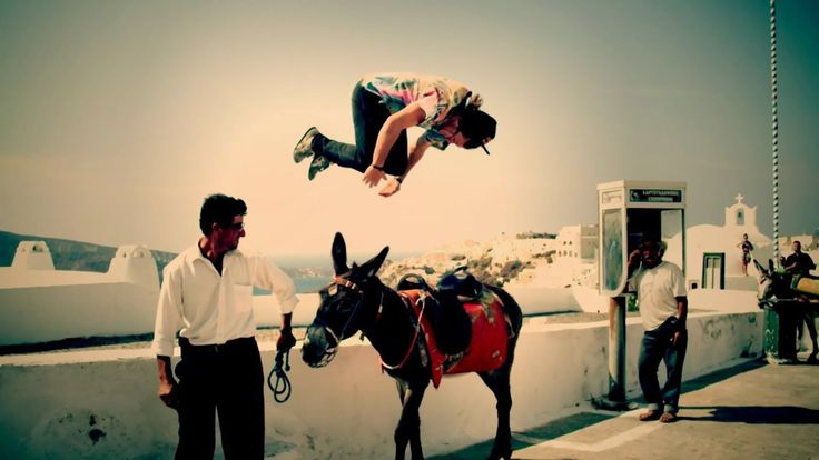 A very strange way to mount a donkey in Oia village, Santorini island, Greece - selected by www.oiamansion.com
