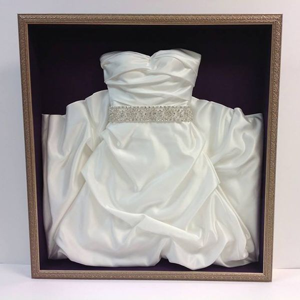 Typically, preserving your wedding gown means it's going to sit in a box in your closet for the next few decades until you pull it out and see if your daughter wants to wear it on her own wedding day. Instead, why not put it on display in your closet? You'll get a little thrill every time you see it, while still keeping it in tip-top shape in case your daughter actually does want to wear it.