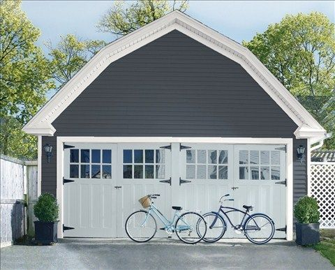 Look at the paint color combination I created with Benjamin Moore. Via @benjamin_moore. Siding: Gravel Gray 2127-30; Trim: American White 2112-70; Garage Doors: Silver Gray 2131-60.