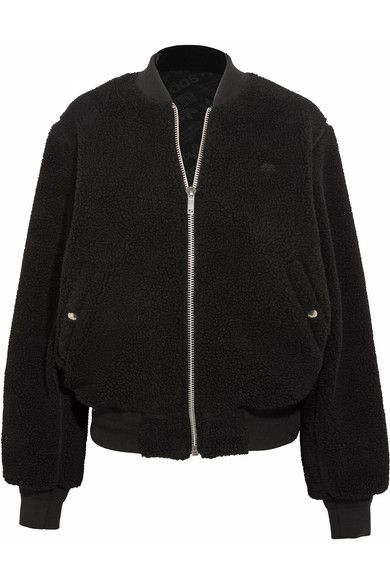 Alexander Wang wore adidas Originals as a child at boarding school and for Spring '17 he's debuting his own collection with the streetwear label. This reversible bomber jacket is made from cozy fleece on one side and lustrous monogrammed jacquard on the other, and has interior and exterior pockets. Team yours with track pants from the collaboration.