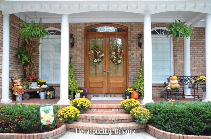 Beautiful front porch... Gorgeous front door!