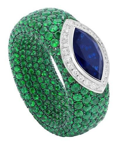 Avakian cache ring with pave emeralds and a marquise-cut sapphire.