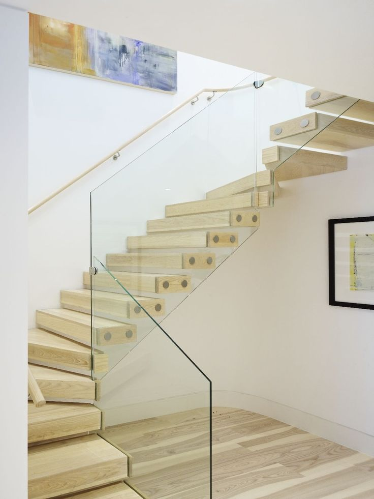 Feature cantilevered stair to one of the duplex apartments with floating limed ash treads and frameless glass balustrade.